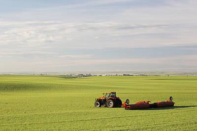 Tractor In A Green Grain Field Pulling Art Print
