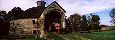 Round Barn Photograph - Tractor Parked Inside Of A Round Barn by Panoramic Images