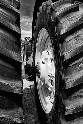 Photograph - Tractor Tires Detail Black And White by Ann Powell