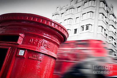 British Photograph - Traditional Red Mail Letter Box And Red Bus In Motion In London, The Uk by Michal Bednarek