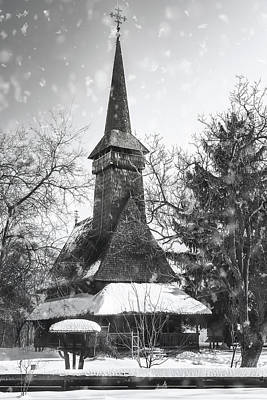 Curated Beach Towels - Traditional Romanian wooden Church covered in snow in black and  by Daniela Constantinescu