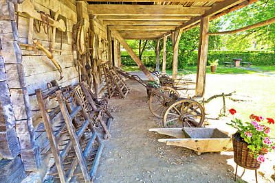 Photograph - Traditional Wooden Cottage And Agricultural Tools In Rural Regio by Brch Photography