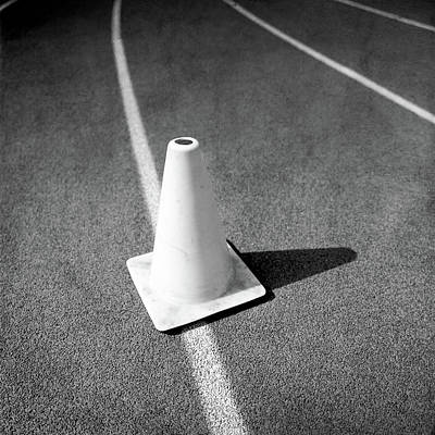 Photograph - Traffic Cone On Runners Track Lanes In Bw by YoPedro