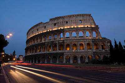 Traffic Goes By The Colosseum At Night Art Print by Joel Sartore