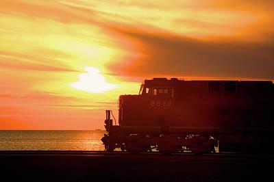 Train And Sunset Art Print by Paul Kloschinsky