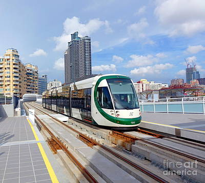 Photograph - Train Of The New Light Rail System by Yali Shi