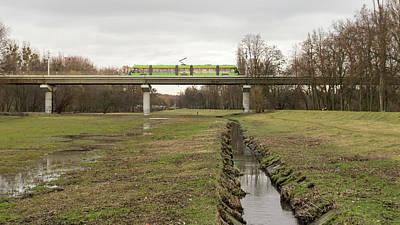 Photograph - Tram On A Viaduct Poznan Poland by Jacek Wojnarowski