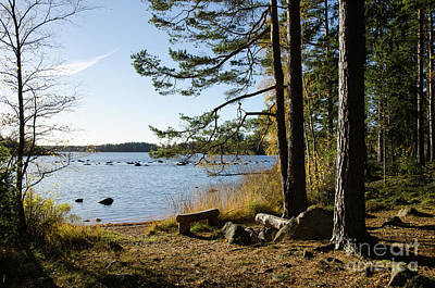 Photograph - Tranquil View At A Blue Lake With A Bench By Fall by Kennerth and Birgitta Kullman