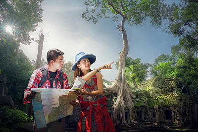 Photograph - Traveler Finding Next Camping Point By A Map by Anek Suwannaphoom