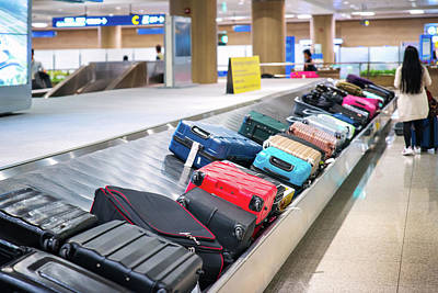 Photograph - Traveler Waiting For A Travel Bag On The Belt In Airport by Anek Suwannaphoom