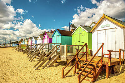 Greenman Photograph - Treetops. A Colourful Fine Art Photographic Print Of Beach Huts On The Seafront At Felixstowe. by Lee Thornberry