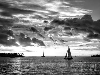 Photograph - Tres Sailboats At Sunset In Key West Monochrome by John Rizzuto