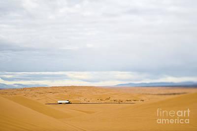Semi Dry Photograph - Truck Driving Through Desert by Eddy Joaquim