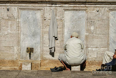 Photograph - Turkish Man Washing Feet Near Mosque by Patricia Hofmeester