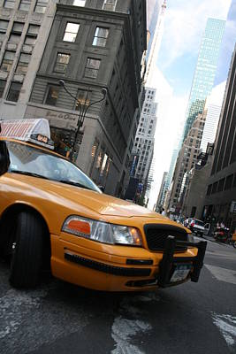 Turning Taxi Art Print by Jeff Porter