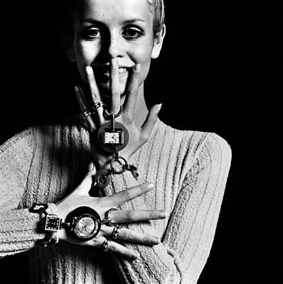 Photograph - Twiggy Wearing Watch Jewelry by Bert Stern