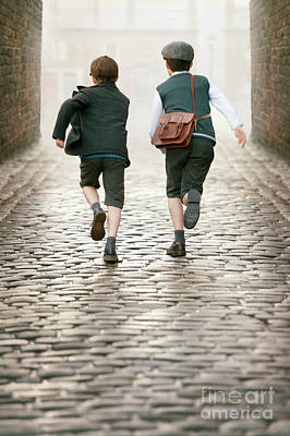 Photograph - Two 1940s Boys Running Down A Cobbled Alleyway by Lee Avison