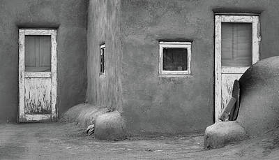 Photograph - Two Blue - Taos Pueblo In Black And White by Nadalyn Larsen