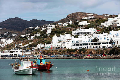 Buildings In The Harbor Photograph - Two Boats In The Mykonos Harbor by John Rizzuto