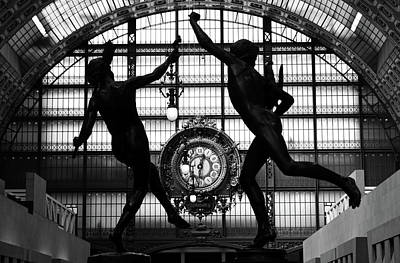 Photograph - Two Bronze Sculptures Framing Great Gold Clock Orsay Museum Great Hall Paris France Black And White by Shawn O'Brien