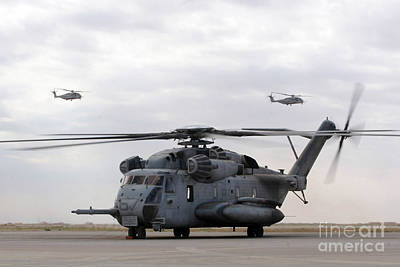 Middle Ground Photograph - Two Ch-53e Super Stallion Helicopters by Stocktrek Images
