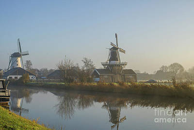 Photograph - Two Dutch Windmills In The Fog by Patricia Hofmeester