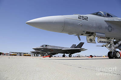 Liberty Painting - Two F-35c Lightning II Aircraft Are Parked Next To Two F A-18f Super Hornets by Celestial Images