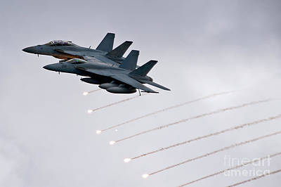 Two Fa-18 Super Hornets Drop Flares Print by Celestial Images