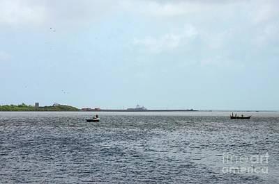 Photograph - Two Fishing Boats At Creek Off Arabia Sea Karachi Pakistan by Imran Ahmed