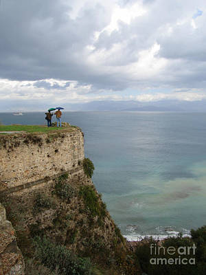 Two Friends Peer Over A Cliff And See The Horizon Art Print
