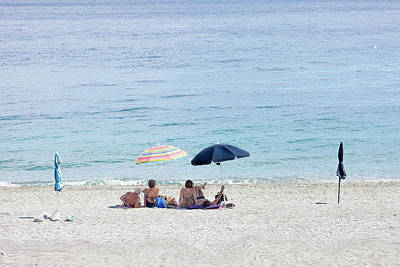 Photograph - Two Generation Couples Under The Umbrellas To Hide From The Sun, by Alfio Finocchiaro