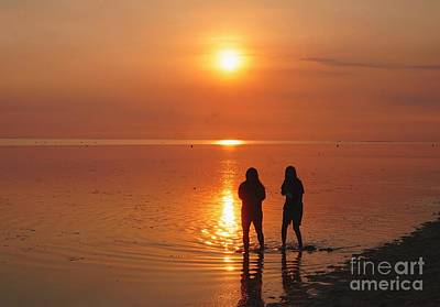 Photograph - Two Girls At Sunset On Philippines Sea by Christopher Shellhammer