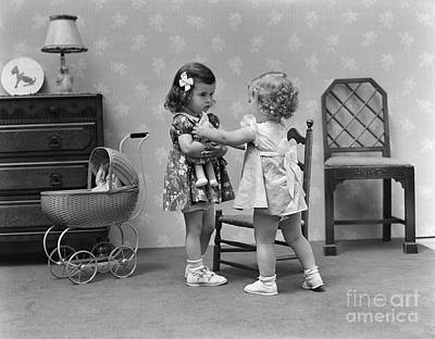 Two Girls Playing With Dolls, C.1940s Art Print by H. Armstrong Roberts/ClassicStock