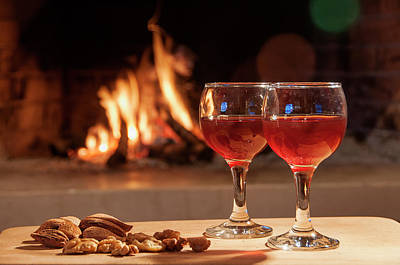 Photograph - Two Glass Of Wine In Front Of A Fireplace by Manolis Tsantakis