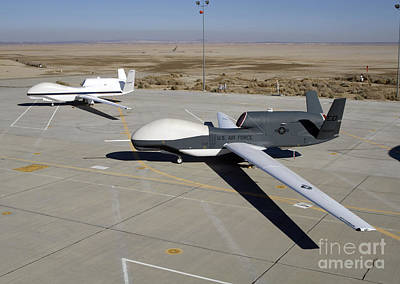 Two Global Hawks Parked On A Ramp Art Print by Stocktrek Images