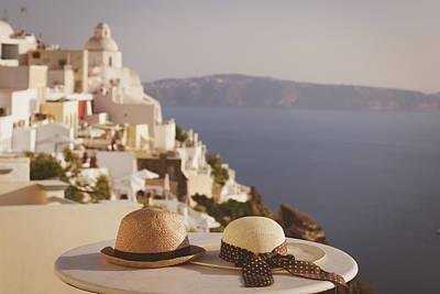 Vacation Photograph - two hats on Santorini island image of honeymoon by NadyaEugene Photography