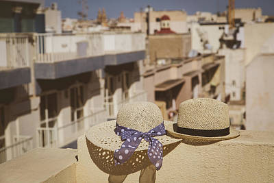 Luxury Photograph - two hats on the balcony in European city, vacation concept by NadyaEugene Photography