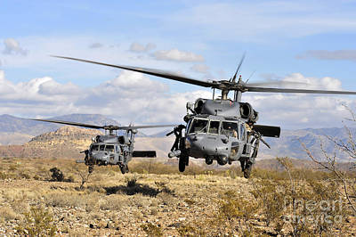 Photograph - Two Hh-60 Pavehawk Helicopters by Stocktrek Images