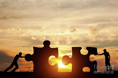 Goal Photograph - Two Men Connect Two Puzzle Pieces. Concept Of Business Solution, Solving A Problem. by Michal Bednarek