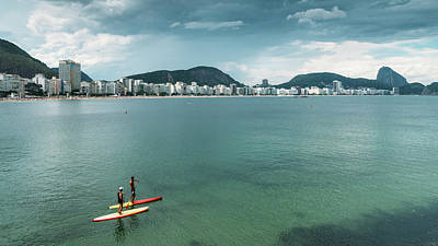 Photograph - Two Men On A Stand Up Paddle On Copacabana Beach by Alexandre Rotenberg