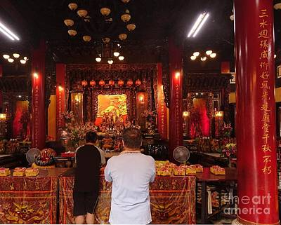 Photograph - Two Men Pray At The Altar Of A Temple In Taiwan by Yali Shi
