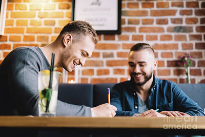 Photograph - Two Men Sitting In A Restaurant And Laughing. by Michal Bednarek