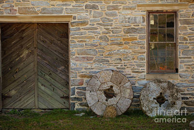 Two Mill Stones Against Building Art Print