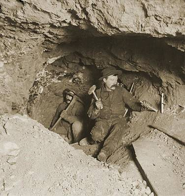 Two Miners Taking Out Ore In Tunnel Art Print by Everett