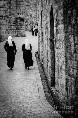 Photograph - Two Nuns Walk Down St Dominika Street, Black And White, Dubrovnik, Croatia by Global Light Photography - Nicole Leffer