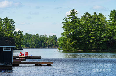 Photograph - Two Red Chairs On A Dock by Les Palenik
