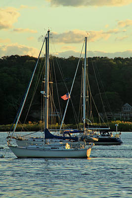 Photograph - Two Sailboats Anchored In River Bathed In Yellow Glow by Mike M Burke