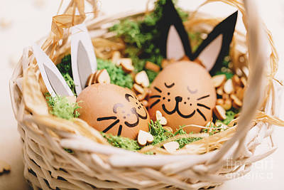 Photograph - Two Smiling Egg-bunnies Laying In The Basket. by Michal Bednarek