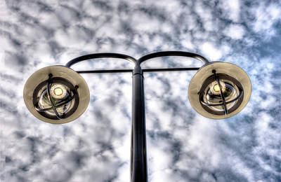 Photograph - Two Streetlamps Under A Cloudy Sky by Gary Slawsky