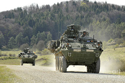 Armored Vehicle Photograph - Two Stryker Vehicles At The Hohenfels by Stocktrek Images